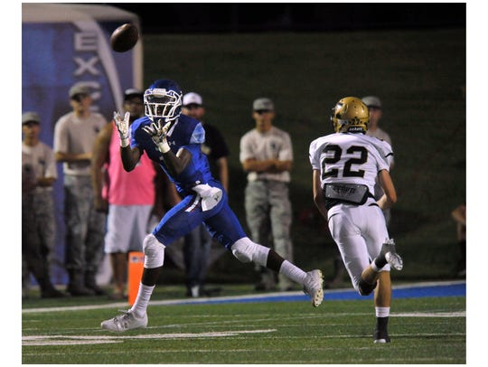 Cooper High School's Myller Royals catches a pass downfield