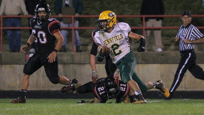 Ryan Ferguson of Pennfield turns down field after making a reception against Marshall.