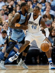 Dallas Mavericks forward Harrison Barnes (40) positions for a shot against Memphis Grizzlies' JaMychal Green during the first half in Dallas, Friday, March 3, 2017.
