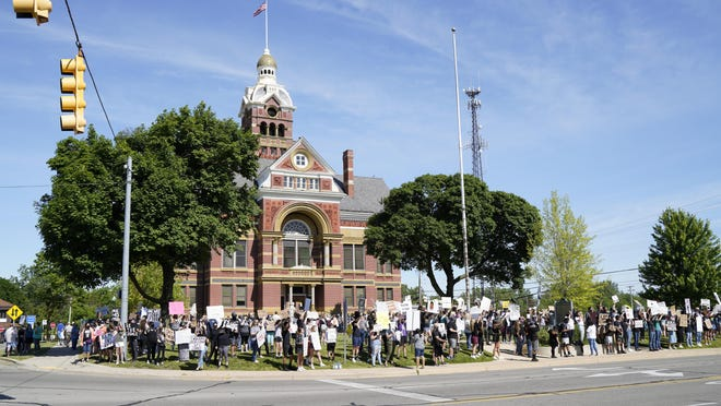 """About 400 people take part in the """"Peaceful Rally and March in Support of Black Lives"""" Sunday at the old Lenawee County Courthouse in Adrian."""