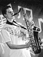 Zachariah Kuzo wails on his saxophone in this undated