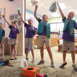 """Members of the Junior Girls Scout Troop #673 perform with instruments they made from recycled materials during the 2nd Annual Upcycle Art Fest at J.N. """"Ding"""" Darling National Wildlife Refuge on Wednesday."""