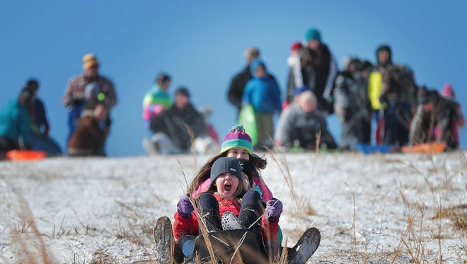 Kids line up on the bluff at Collierville's landfill Tuesday morning for sledding at one of the area's best spots. A crowd of almost 100 snow fans rotated on and off the hill taking advantage of a rare snow day in the Mid-South after the second snowstorm in four days moved into the Memphis area over night blanketing the area in up to three inches of snow.