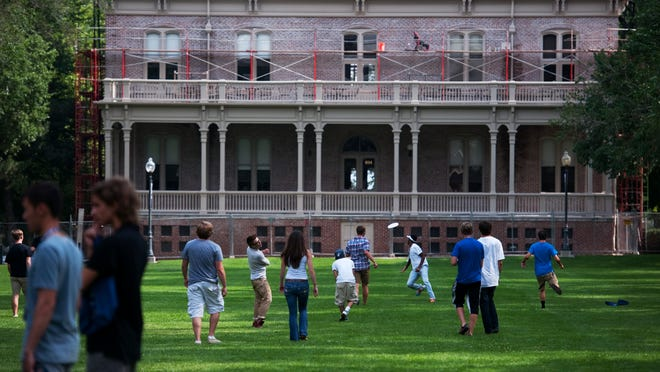 New students play Frisbee and other games on the quad at the University of Nevada, Reno campus. The university is holding a summer internship expo with Tesla Motors this month.