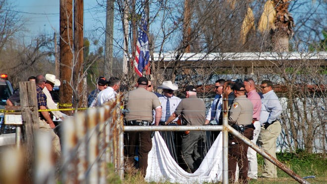 Law enforcement officials with the Tom Green County Sheriff's Office work a crime scene following the discovery of a body in a dumpster in the 1000 block of Cactus Lane in North San Angelo. Mar. 20, 2018