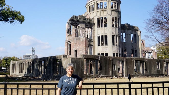 Ann Kappaz of Troy took the D to Hiroshima, Japan, last month. The building in the background is a ruin that serves as a memorial to people  killed in the World War II bombing of the city on Aug. 6, 1945.  Kappaz visited Hiroshima with her son,  Eric Kappaz, who is teaching in China.