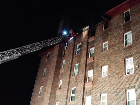 Firefighters battle a three-alarm fire in Avondale