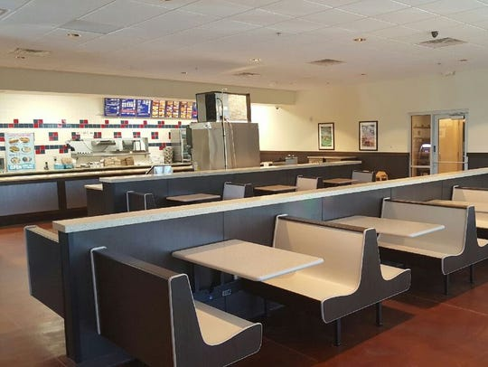 The just-opened Tom's Drive In has seating inside for