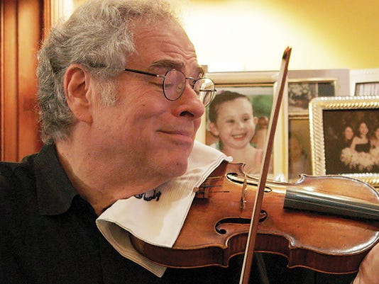 Perlman-plays-violin-in-doc.jpg