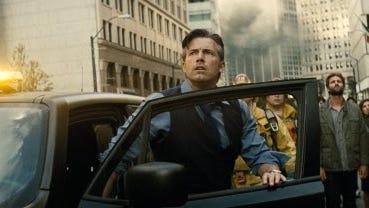 Bruce Wayne (Ben Affleck) watches as a city crumbles in 'Batman v Superman: Dawn of Justice.'