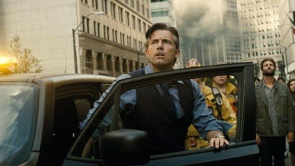Bruce Wayne (Ben Affleck) watches as a city crumbles