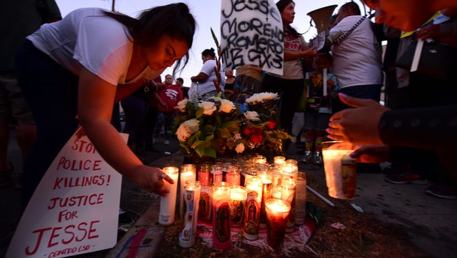 People leave candles at a memorial for 14-year-old Jesse Romero in the Boyle Heights section of Los Angeles.