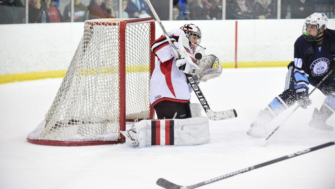 Livonia Churchill goalie Andrew Broyles makes a stop against a Livonia Stevenson player during a game earlier this season. Broyles turned in a valiant effort Thursday against the top team in Division 2, Hartland.