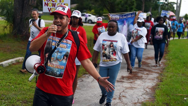 Michael Marsh, who lives in southern Indian River County, and Yolanda Clayton-Woods (right), of Vero Beach, lead a group of about 100 people on a march down 45th Street in Gifford on Sunday, June 4, 2017, to bring attention to the death of Alteria Woods during a drug raid by the Indian River County Sheriff's Office in March. Marsh asked County Commissioners Tuesday for support in equipping deputies with body cameras.
