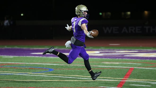 Notre Dame Prep's Jake Smith (1) celebrates as he heads into the end zone for a touchdown during the first half against Desert Edge at Notre Dame Prep in Scottsdale, Ariz. on November 3, 2017.