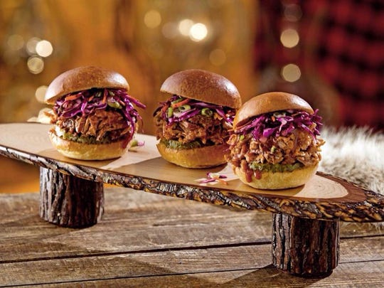 Pulled pork sliders are piled high with spicy meat at Twin Peaks.