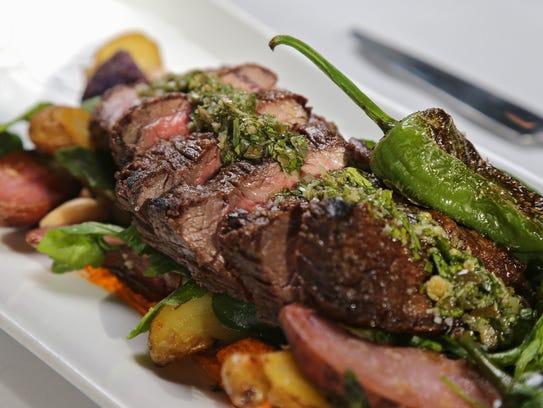 Steak with romesco, potatoes, piquillos, arugula, marcona