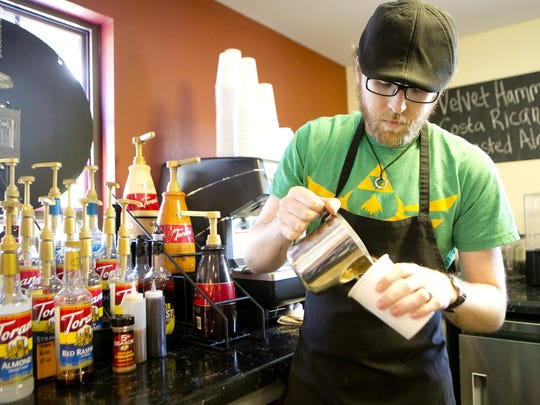 Director of coffee Ben Hall makes a cappuccino at Mission Coffee House on Friday in Plover.