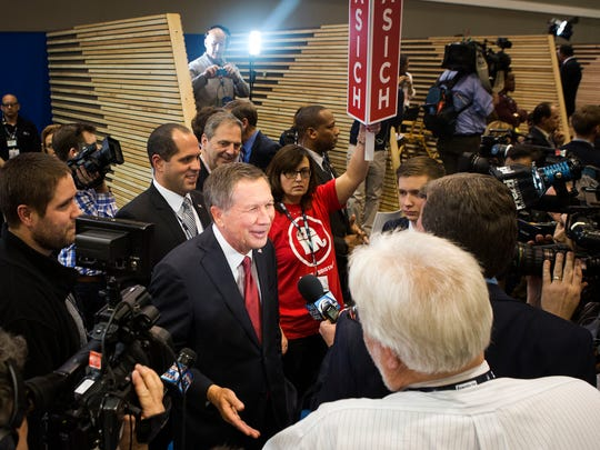 Ohio Governor John Kasich answers questions from the media in the spin room, after the Republican Presidential Debate at Saint Anselm College in Manchester, N.H. on Saturday, Feb. 6, 2016.