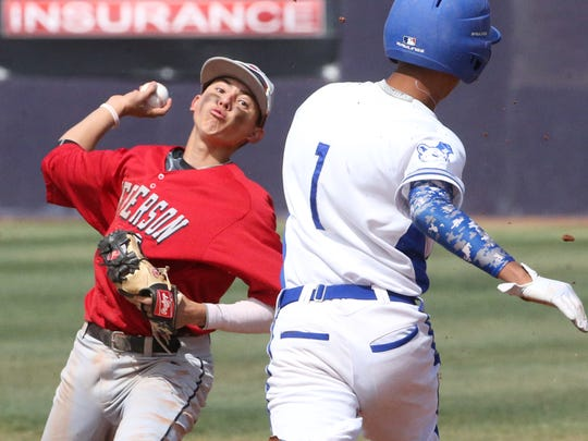 Jefferson's Mathew Chacon fires to first base for a double play as Bowie's Nathan Felix, 1, is forced out at second Saturday.