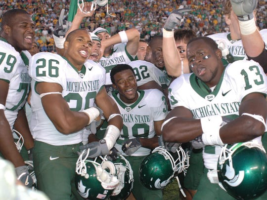 Michigan State players from left, Jesse Miller (79),