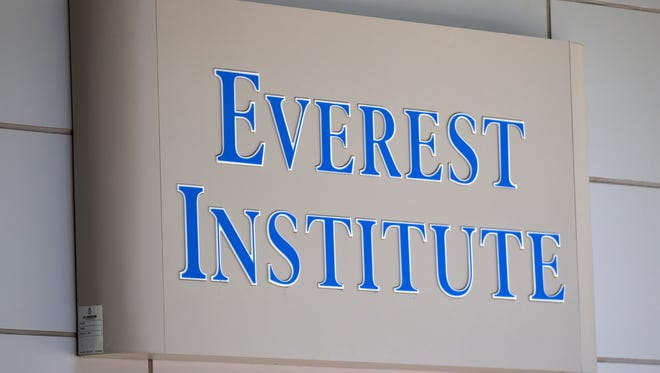 This July 8, 2014 file photo shows an Everest Institute sign on an office building in Silver Spring, Md.