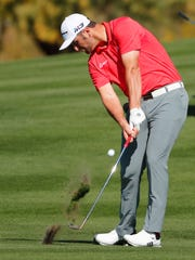 Jon Rahm hits his second shot on the second hole during
