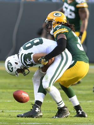 Green Bay Packers cornerback Davon House (31) breaks up a pass attempt to wide receiver Eric Decker (87) against the New York Jets at Lambeau Field.