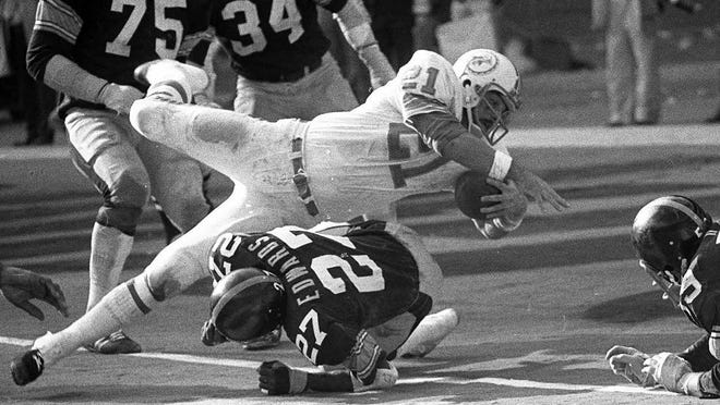 Miami Dolphins running back Jim Kiick goes headfirst over the Pittsburgh Steelers' Glen Edwards for a touchdown in the third quarter of the AFC championship game at Pittsburgh's Three Rivers Stadium in 1972.