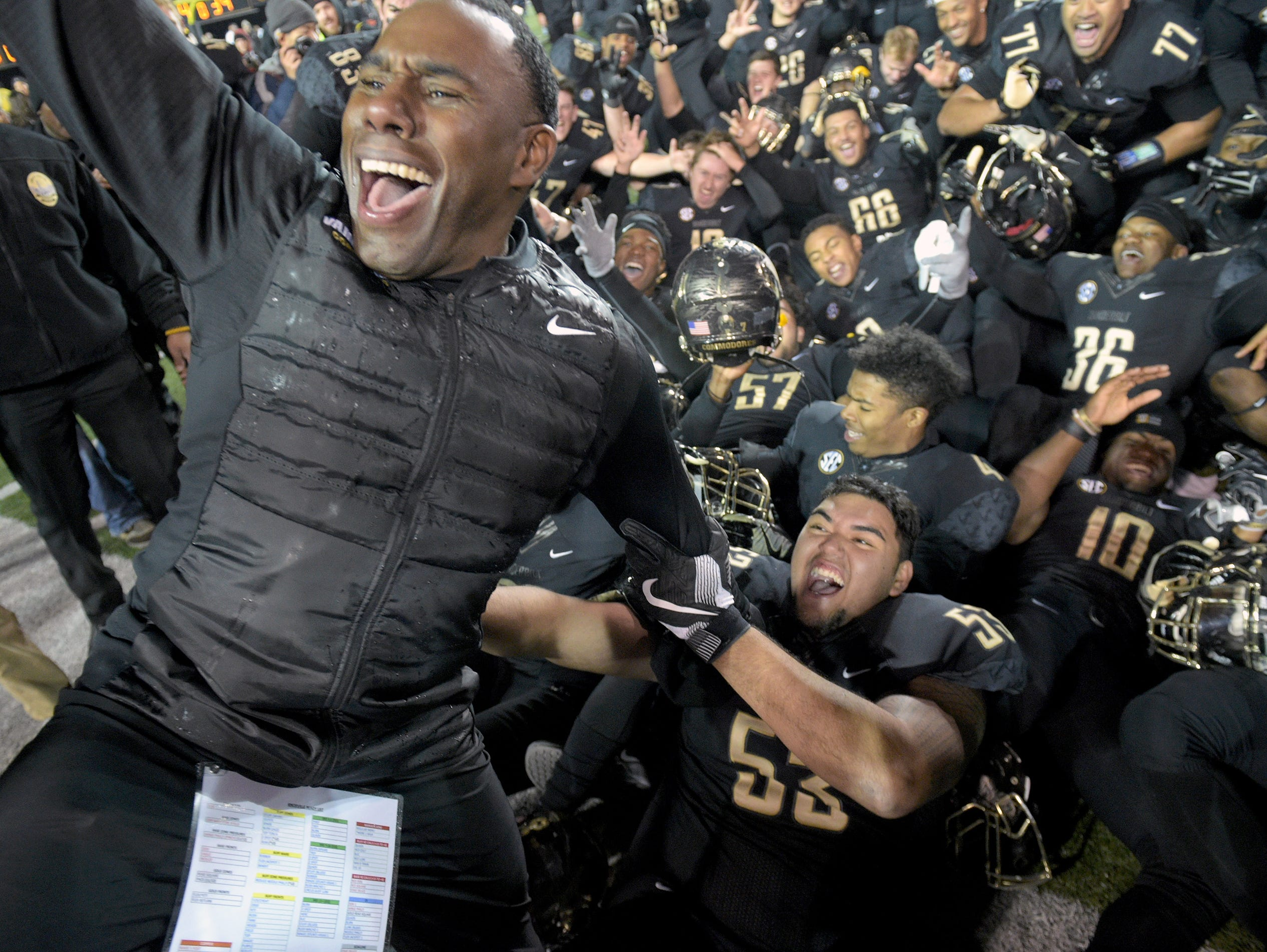 Vanderbilt coach Derek Mason celebrates his team's 45-34 upset win over 24th-ranked Tennessee on Nov. 26, 2016, at Vanderbilt Stadium.