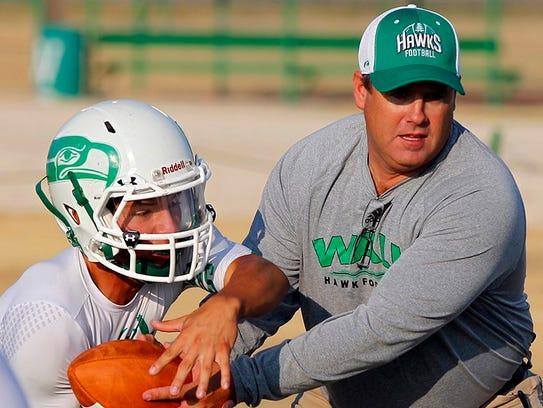 Wall High School head football coach Houston Guy demonstrates