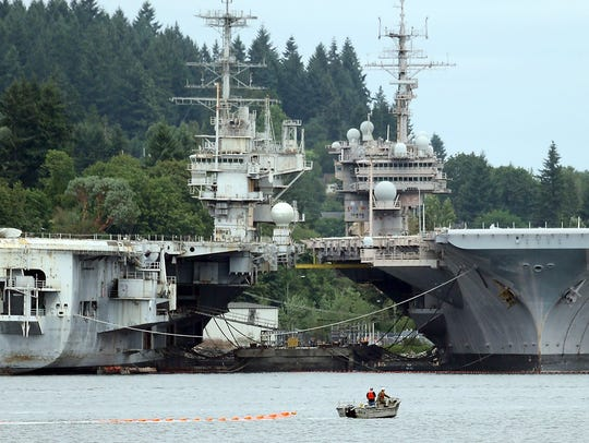 The Independence and the Kitty Hawk in 2015 at Naval Base Kitsap-Bremerton. The Independence has already been scrapped, and the Kitty Hawk will follow.