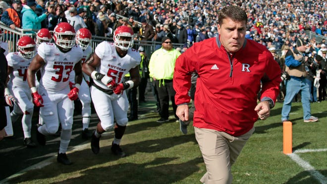 Rutgers coach Chris Ash leads his team onto the field to take on Penn State  on Nov. 11, 2017.