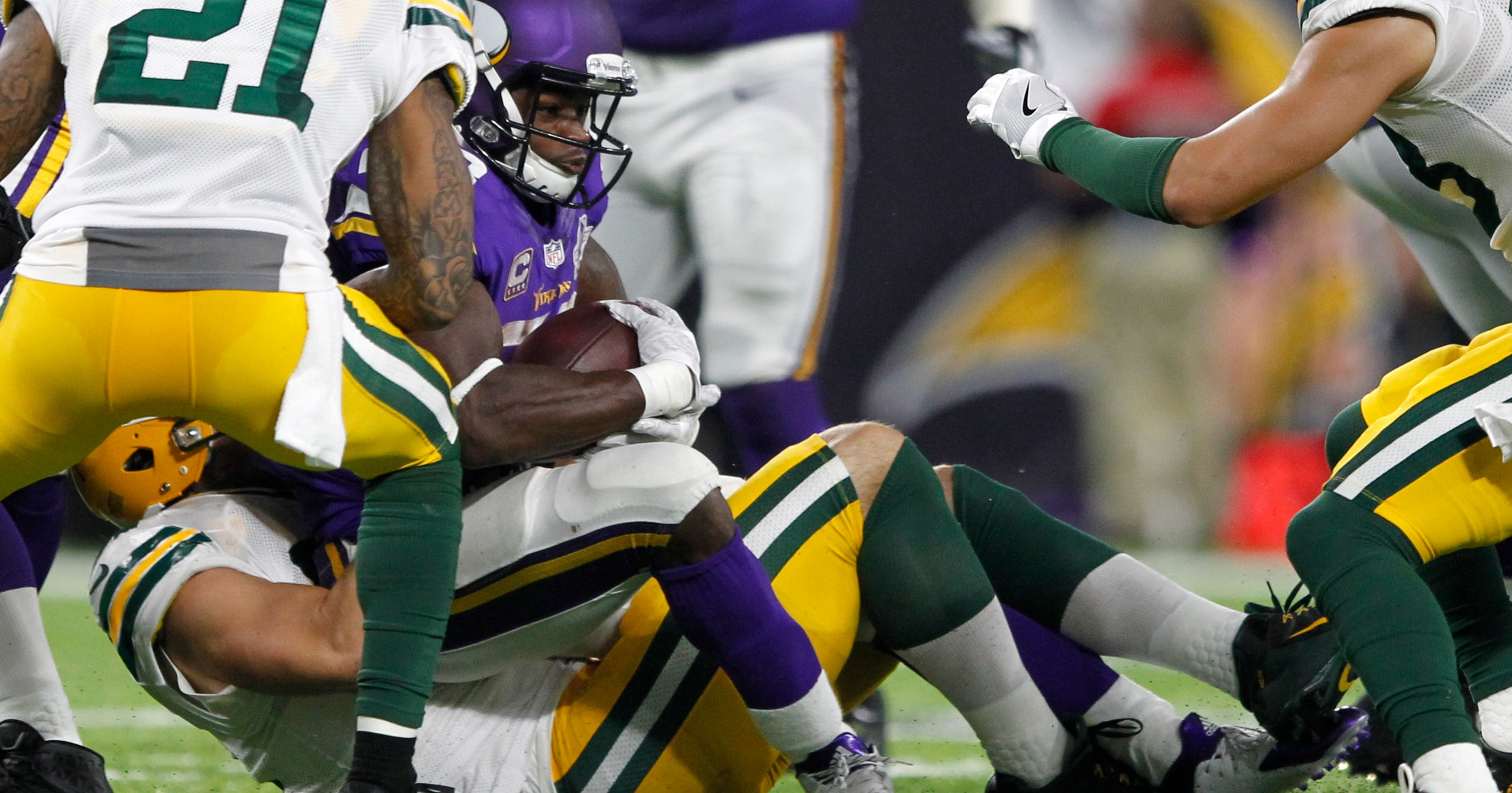 Peterson, Bradford banged up behind leaky offensive line
