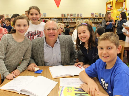 Left to right:  ALT 4th graders Elisabeth Decker, Madison Krowicki, Grace Martin and Francesco Pontoriero read their essays on their dreams for Warren Township and beyond to township mayor George Lazo on April 26.
