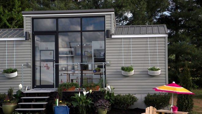 """What does it look like to live in 300 square feet or less? Maybe claustrophobic for some, but the tiny house movement is real as evidenced by this 172 square foot dwelling from FYI TV's new show, """"Tiny House Nation."""""""