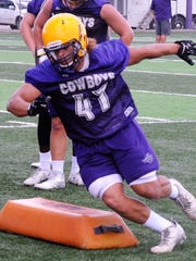 Hardin-Simmons defensive lineman Jim LaFond goes through a drill during Friday's practice.