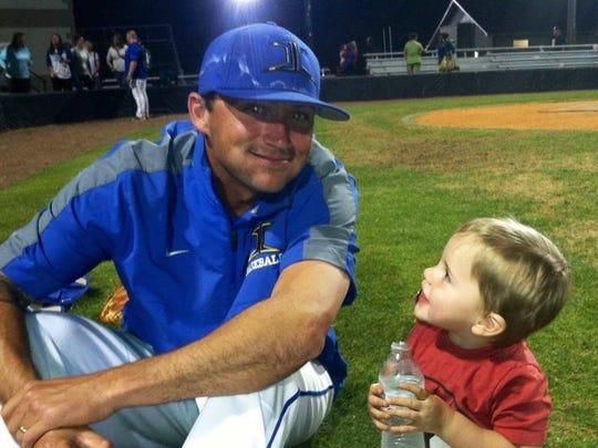 Andrew Crossett with his son Hank.