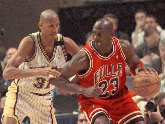 Chicago Bulls' Michael Jordan, right, tries to work toward he basket against Indiana Pacers' Reggie Miller during the first quarter of Game 6 of the Eastern Conference Finals May 29, 1998 in Indianapolis.