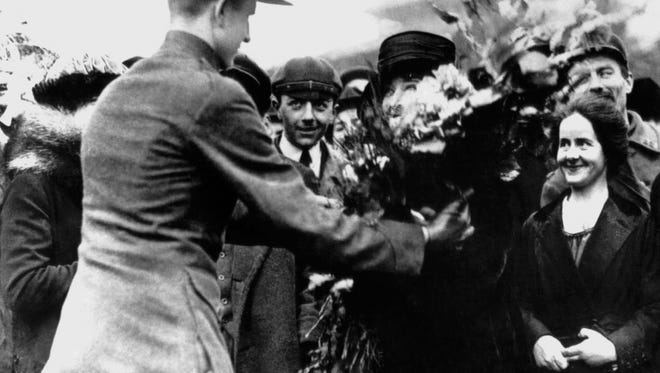 Grateful French women present flowers to wounded Marines in France, following the battle of Belleau Wood in 1918.
