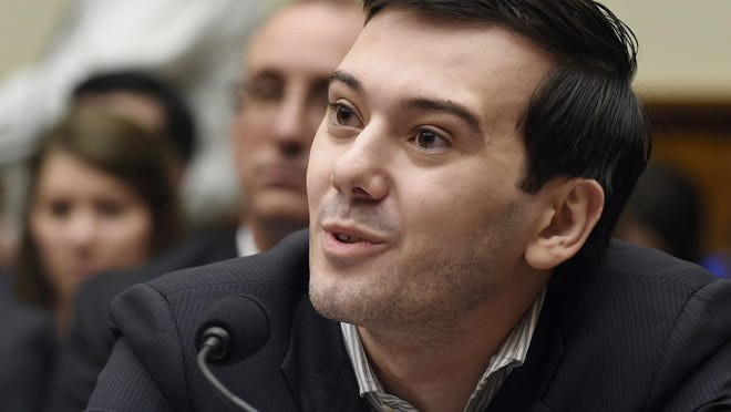 In this Feb. 4 photo, pharmaceutical chief Martin Shkreli speaks on Capitol Hill in Washington during the House Committee on Oversight and Reform Committee hearing on a decision by his former company, Turing Pharmaceuticals, to significantly raise the price of the anti-parasitic medication Daraprim. A bill awaits Vermont Gov. Peter Shumlin's signature that would make it the first state requiring drug companies to explain their price increases.