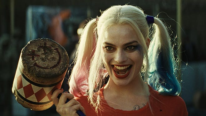 "Margot Robbie, seen here as Harley Quinn in ""Suicide Squad,"" has signed to star in the film adaptation of a book by Milwaukee art gallery owner Dean Jensen."