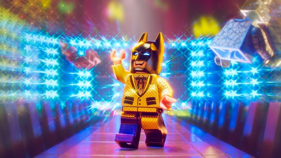 "After making a splash in ""The Lego Movie,"" Lego Batman (voiced by Will Arnett) debuted strongly with his own animated movie."