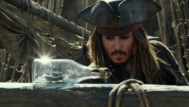 "Captain Jack Sparrow (Johnny Depp) discovers his ship and crew are, well, bottled up in ""Pirates of the Caribbean: Dead Men Tell No Tales."""