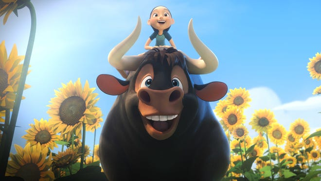 """The title character in """"Ferdinand"""" is a bull who loves smelling flowers."""