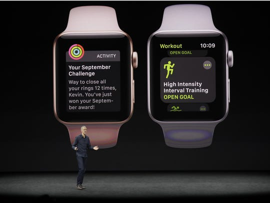 Jeff Williams, Apple's chief operating officer, shows
