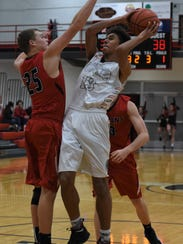 Coshocton's Tyren Walker takes a shot against a Tusky