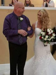 Dan Frazier walks with daughter Kendra Bishop at her wedding in October.