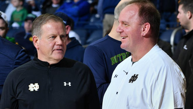 Feb 7, 2017; South Bend, IN, USA; Notre Dame Fighting Irish head football coach Brian Kelly and his defensive coordinator Mike Elko watch warmups before the game between the Notre Dame Fighting Irish and the Wake Forest Demon Deacons at the Purcell Pavilion. Mandatory Credit: Matt Cashore-USA TODAY Sports