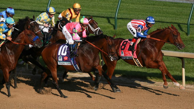 Dortmund and jockey Martin Garcia, right, and Firing Line and jockey Gary Stevens lead coming down the first stretch during the 141st Kentucky Derby. May 2, 2015